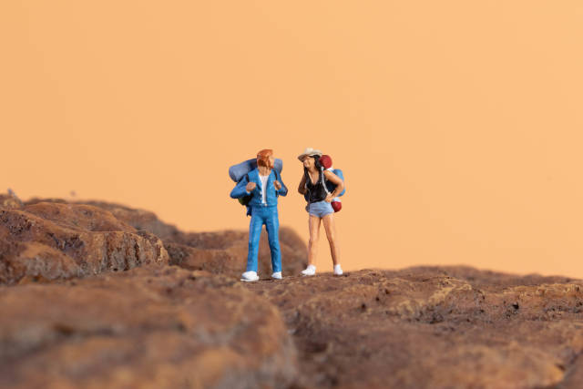 Two hikers standing on rocks