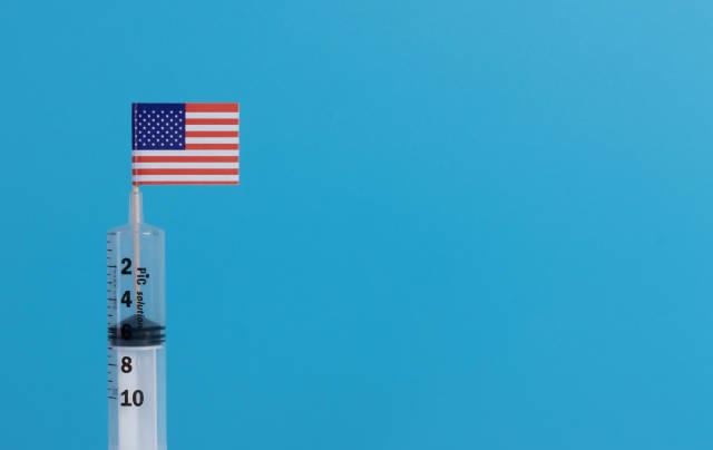 Syringe with flag of USA on blue background
