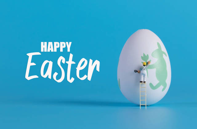 Miniature painter painting easter egg and Happy Easter text