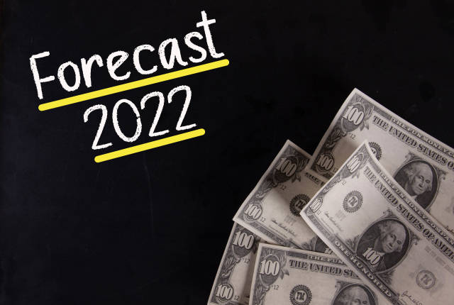 Dollar banknotes with Forecast 2022 text
