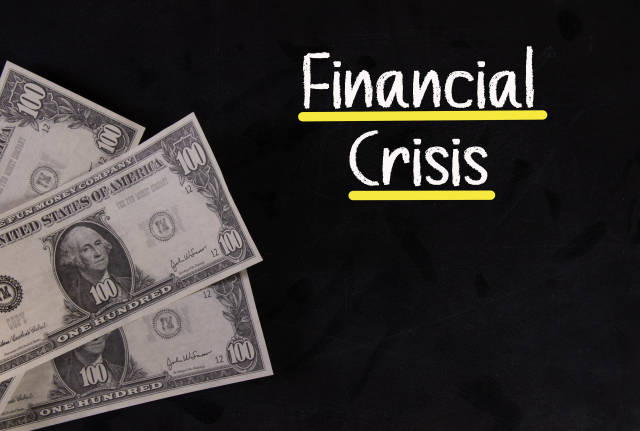 Dollar banknotes with Financial Crisis text
