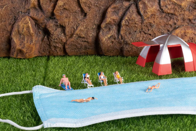Group of miniature people relaxing in the nature