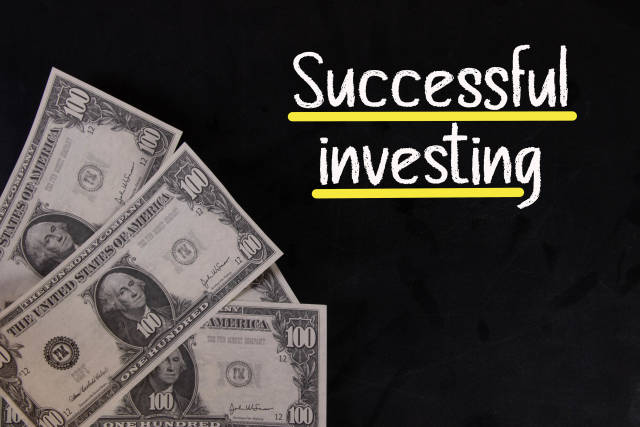 Dollar banknotes with Successful investing text
