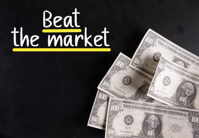 Dollar banknotes with Beat the market text