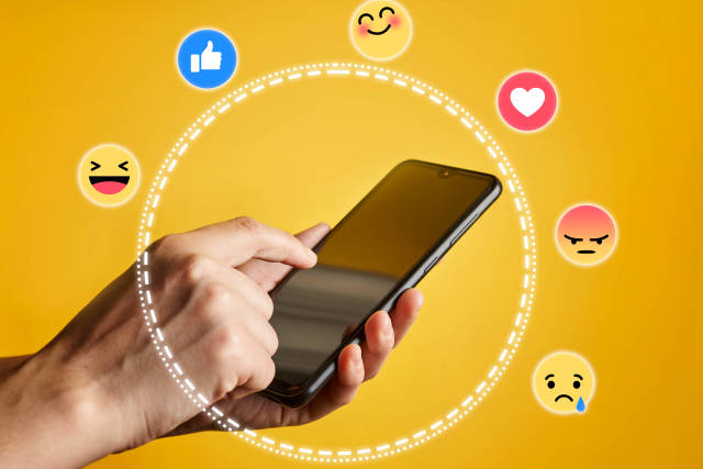 Female hand holding smartphone, surrounded with social media icons