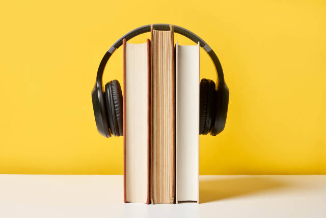 Headphone hanging on a text book