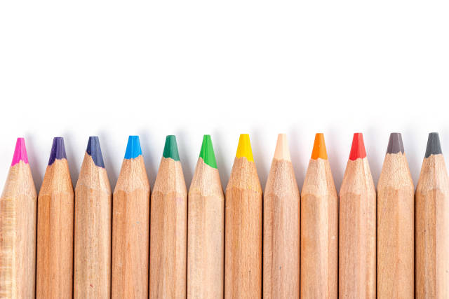 Line of wooden colored pencils
