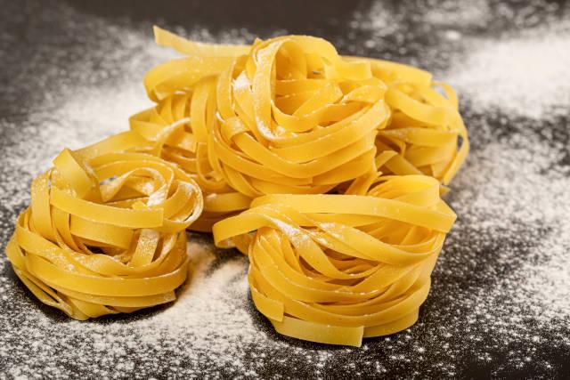 Italian rolled fresh fettuccine pasta with flour