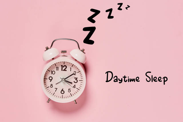 Daytime Sleep concept with alarm clock