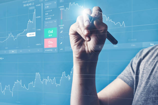 Analyst viewing financial stock market data on the holographic screen