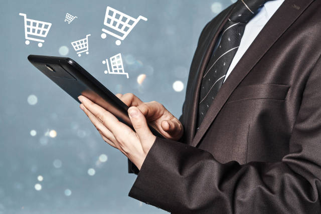 Businessman with a tablet. Online shopping and eCommerce concepts