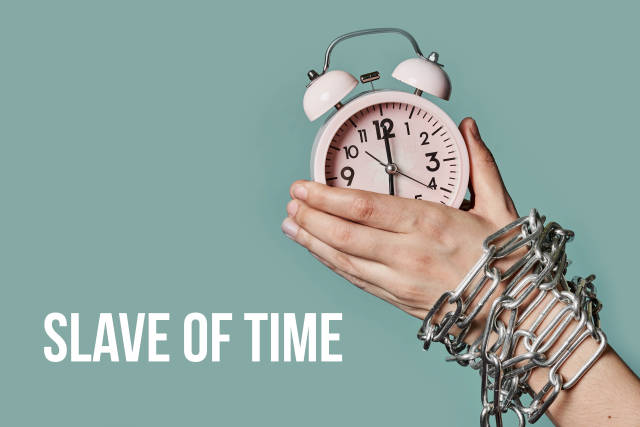 Slave of time concept with chained arm and alarm clock