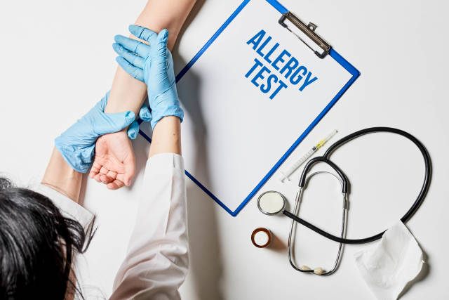 A top view of a doctor testing for allergy to a patient. Medical Concept