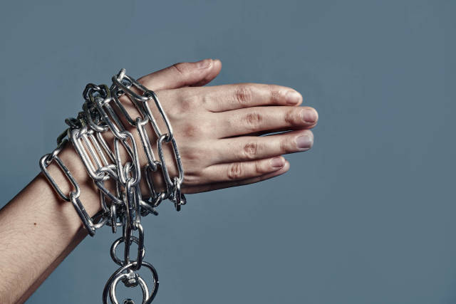 Chained hands of a slave