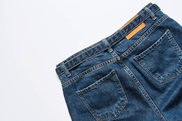 Cropped shot of jeans on white background