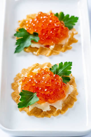 Waffles with cheese cream and red caviar