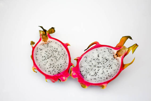Sliced Dragon Fruit on a White Background
