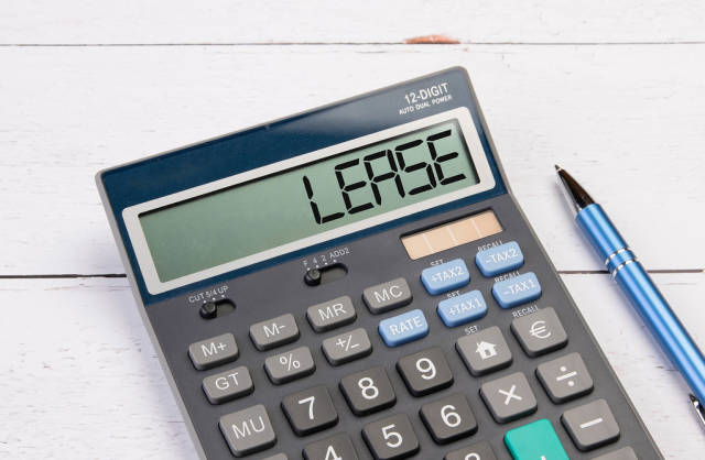 Calculator with the word Lease on the display