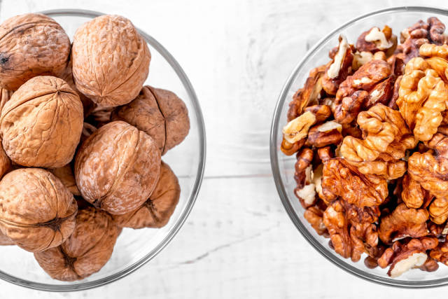Walnuts on white wooden background
