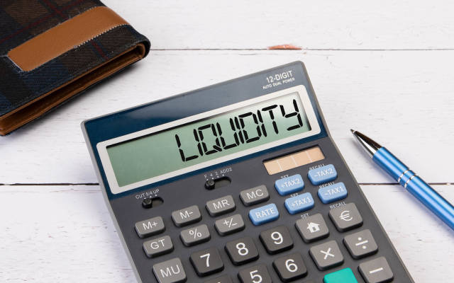 Calculator with the word Liquidity on the display