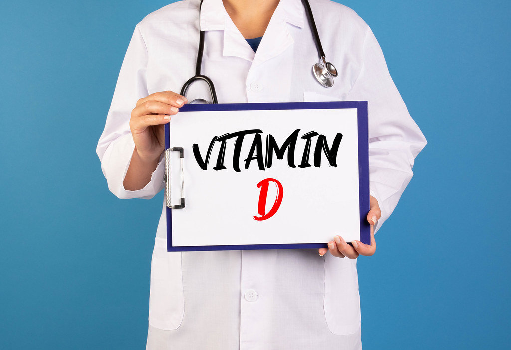 Doctor holding clipboard with Vitamin D text