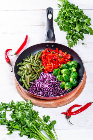 Cooking with fresh vegetables and herbs