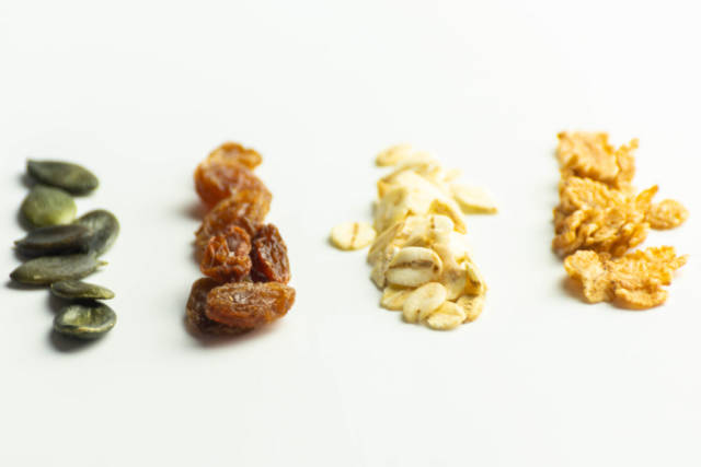 Mix of various additions of cornflakes, grains, pumpkin seeds and raisins