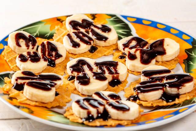 Banana waffle with chocolate on plate