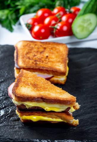 Fried toast whole and half on a black stone tray