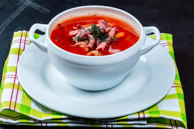 Fresh Solyanka soup on a kitchen towel