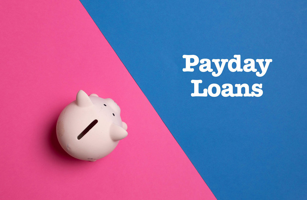 Piggy bank with Payday Loans text