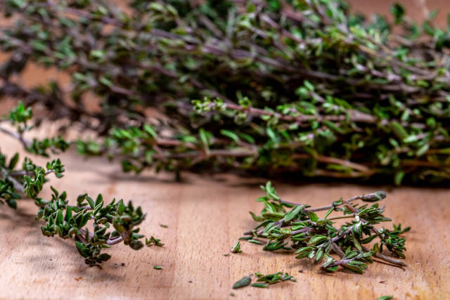 Close-up of thyme grass on wooden background