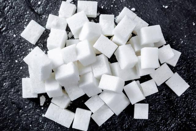 lump sugar cube on black background