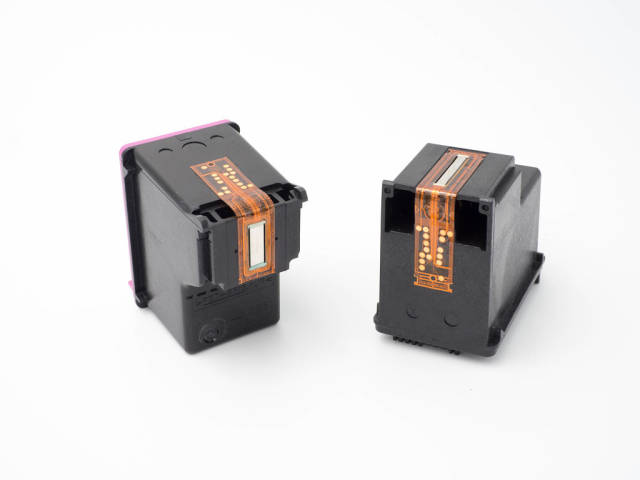 Close-up of empty ink cartridges on white background