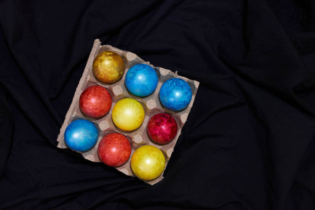 Easter concept. Painted easter festive eggs on the dark textile