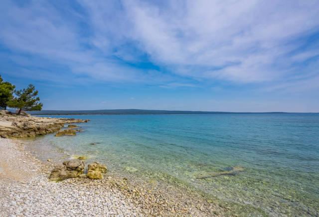 Lonely pebble beach on island Losinj, Croatia