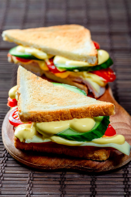 Sandwiches triangular with ham, cheese, tomatoes, lettuce, and toasted bread