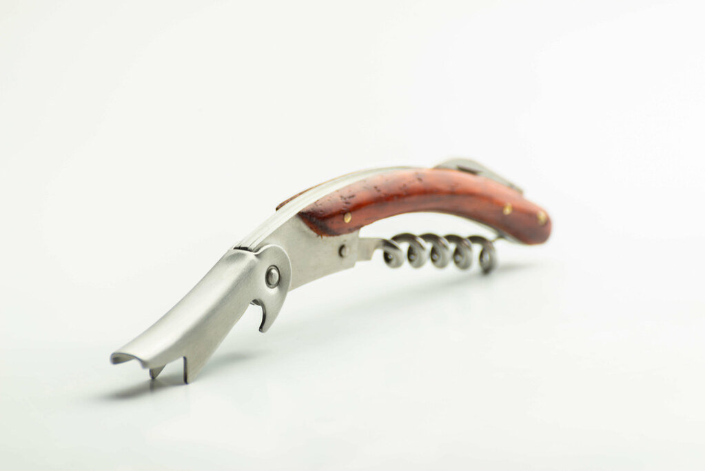 A professional corkscrew for opening a wine bottle