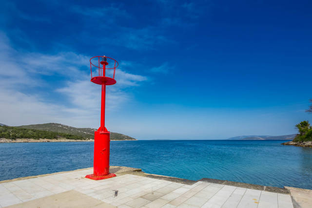 Red lighthouse on island Cres, Croatia