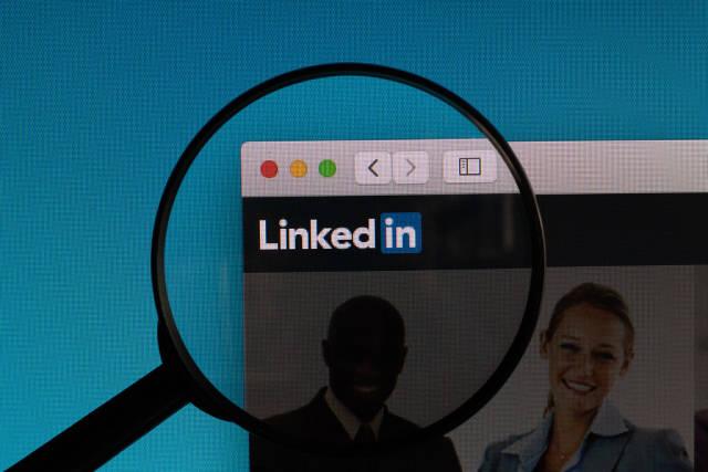 Linkedin logo under magnifying glass