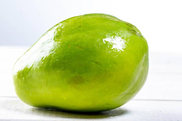 Whole ripe papaya fruit on white background