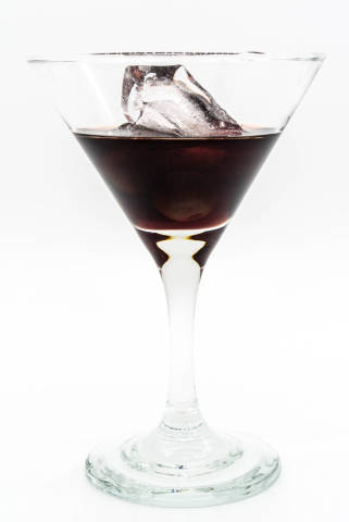 Cherry Brandy in a coctail glass with ice cube