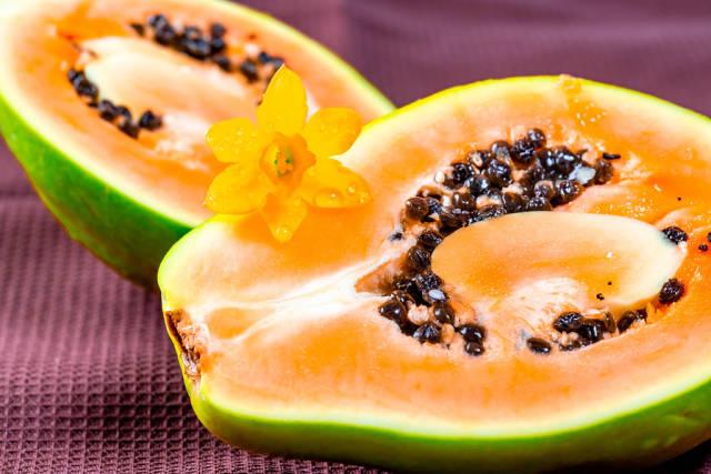 Halves of fresh papaya fruit with seeds