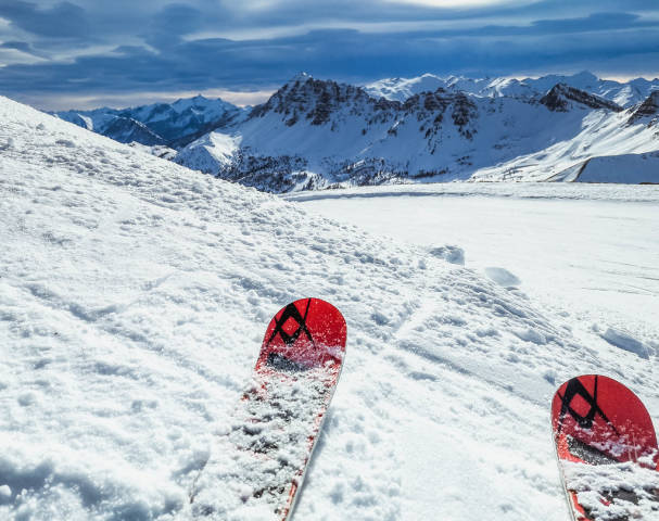 Skiing in high mountains at sunny day