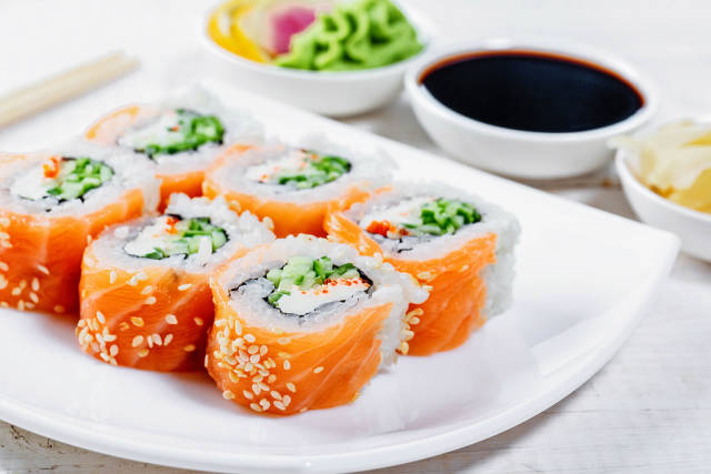 Sushi philadelphia with sauce, ginger and wasabi