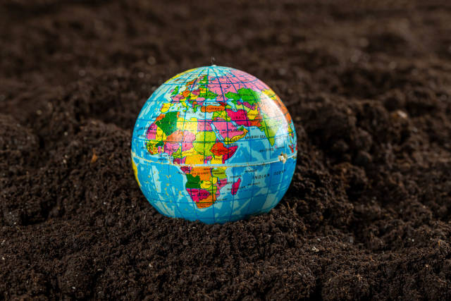 Earth on fertile soil, saving environment, earth day, conservation world concept