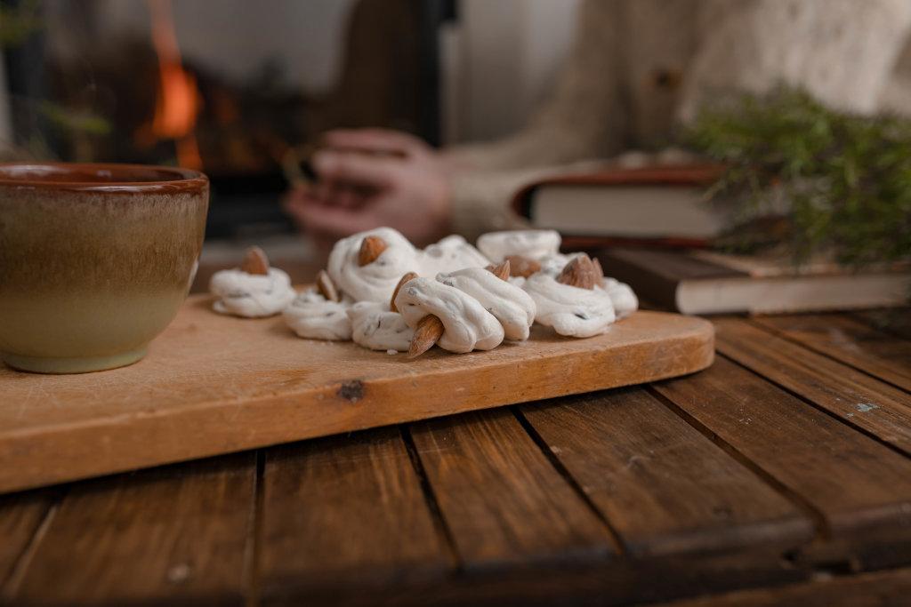 Meringue Beze Cookies On Wooden Table