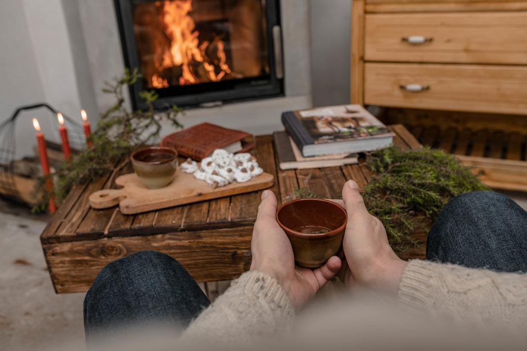 Drinking Hot Tea Near Fireplace