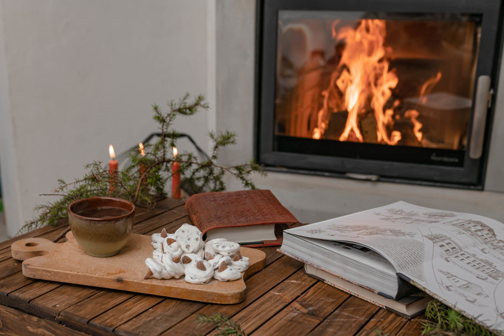 Romantic Winter Hygge Mood With Fireplace And Tea