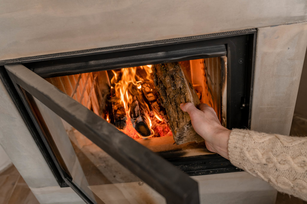 Setting Fireplace With Wood By Hand